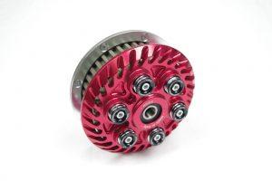 Einstellbare sechsfeder Antiopping Kupplung der Firma Kbike in der Farbe rot ohne Spinnfeder.
